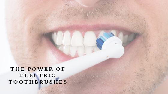 Man using an electric toothbrush