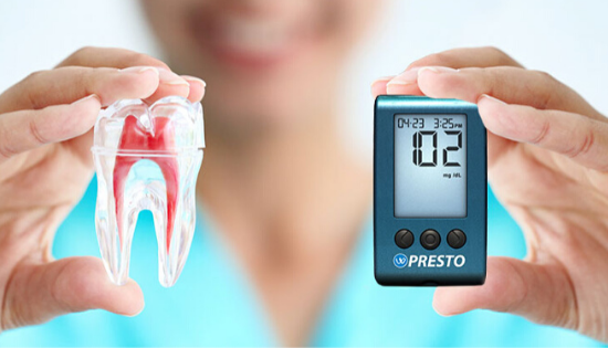 Dentist holding up a tooth and a glucose meter